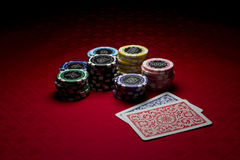 Poker chips and two cards Royalty Free Stock Images