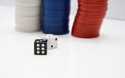 Poker Chips with two dice Royalty Free Stock Photography