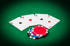 Poker cloth, a deck of cards and chips Royalty Free Stock Image