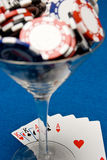Poker cocktail. Cocktail glass full of chips with a full house stock image