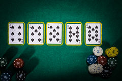 Poker concept with cards on green table. Hand-ranking categories: Straight Flush Stock Image