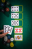 Poker concept with cards on green table. Hand-ranking categories: Straight Flush Royalty Free Stock Photo