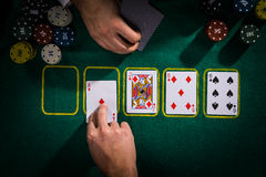 Poker concept with cards on green table. Second deal stock image