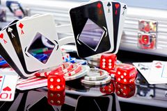 Poker concept playing cards shaped glasses with chips dices and stock photos