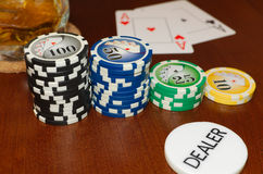 Poker Dealer Button and Casino Tokens with a Pair of Aces Royalty Free Stock Photography