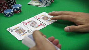 Poker dealer distributes cards stock footage