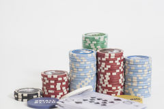 Poker dealer and poker chips stack on white Royalty Free Stock Photos