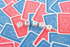 Poker dice in cards background Stock Photos