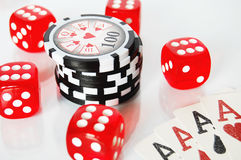 Poker dice, chips and play cards on white background Stock Photos