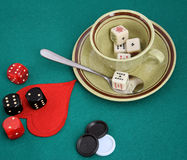 Poker dice on the cup. Stock Image