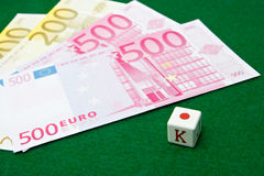Poker dice and euro notes. Poker dice and euro banknotes Stock Images