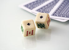 Poker dices. Some poker games: cards and dices, over a white reflecting table Royalty Free Stock Image