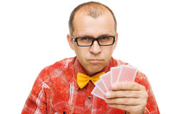 Poker face. Gambler holding playing cards isolated on white background Stock Images