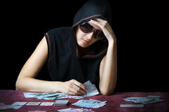 Poker face. Person playing poker Royalty Free Stock Image