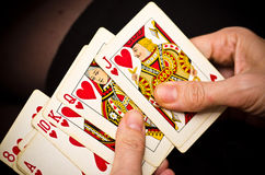 Poker. Female hands holding some cards poker royalty free stock photo