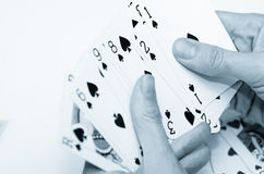 Poker. Female hands holding some cards poker royalty free stock photos