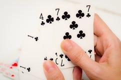 Poker. Female hands holding some cards poker Stock Photo