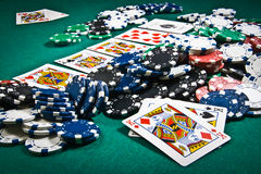 Poker final bet. A straight flush wins over a poker of K royalty free stock image
