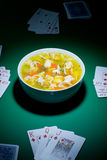 Poker and food Stock Photography
