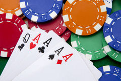 Poker, four aces on a chips background Stock Photography