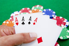Poker, four aces holded in hand Stock Images