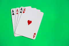 Poker. Four aces of a kind with background Stock Image