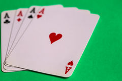 Poker. Four aces of a kind with background Stock Photos