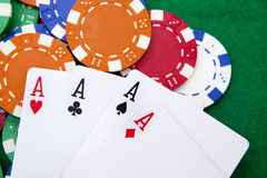 Poker, four aces over a background Stock Images