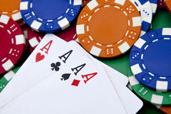 Poker, four aces over a background Stock Photo