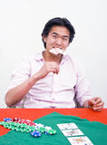 Poker frustration. A frustrated poker player biting his cards after loosing an all in game Royalty Free Stock Photos