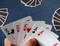 Poker - Full House. The best of poker - Full House win, three cards of equal rank, and two different cards of the equal rank: kings: club, diamond, heart and royalty free stock image