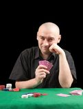 Poker gambler in black shirt in casino. Stock Image