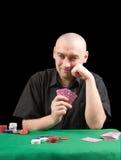 Poker gambler in black shirt in casino. Stock Image