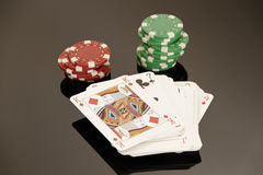Poker gambling. Poker cards with many chips Stock Images