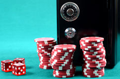 Poker gambling chips on a green playing table Stock Photo