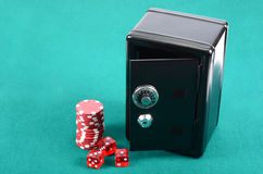 Poker gambling chips on a green playing table Royalty Free Stock Photo
