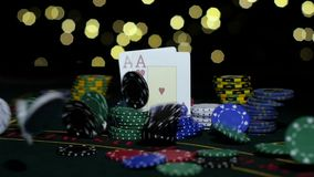Poker gambling. Poker Chips and Two Aces. Close up. Slow motion. Winning hand of playing cards on poker table, pile of chips, winner's gain, combination of poker stock video footage