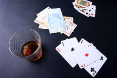 Poker game. With alcohol and euro money Royalty Free Stock Image