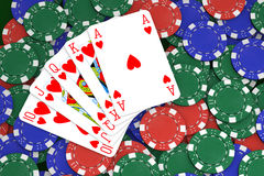 Poker Game. Poker winning hand over a colorful chips background royalty free stock photos