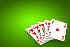 Poker Game. Poker winning hand over a vivid green background royalty free stock photography