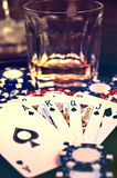 Poker game. Hazard poker game and glass of whiskey Royalty Free Stock Photos