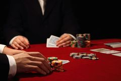 Poker game. Image of high stakes poker game in progress. Both players exude wealth, confidence and success Royalty Free Stock Photos