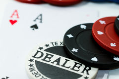 Poker game. Close up on poker chips and cards Stock Photos