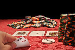 Poker game. Abstract image of poker game with player showing a very strong hand Royalty Free Stock Images