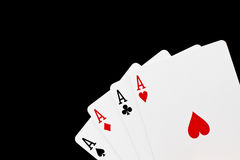 Poker game. A good poker hand with 4 aces isolated on black royalty free stock image