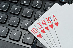 Poker game. Winning hand, with straight flush on keyboard, internet poker concept Stock Photography