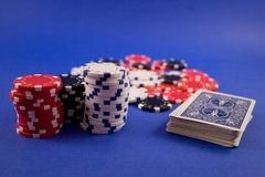 Poker Game. Poker chips and deck of cards await the start of a poker game stock photography