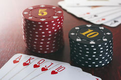 Poker game. Royal flush in play with bets Royalty Free Stock Photography