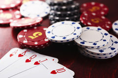 Poker game. Poker hand with the chips Stock Photography