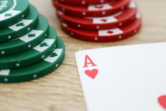 Poker game with ace of hearts and chips. Photo of poker game with ace of hearts and chips Royalty Free Stock Images